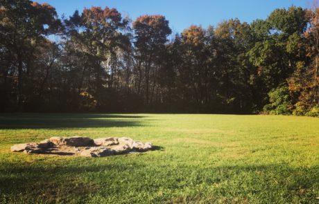 Fire pit on lawn near barn